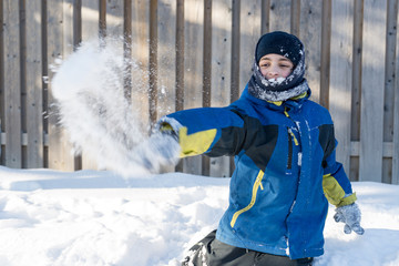 Child Boy Playing with Snow, Throwing Snow Balls
