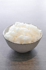 japanese rice in bowl on wood