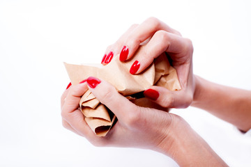 Female hands holding a crumpled paper