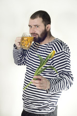 Brutal man gives a flower and drinking beer