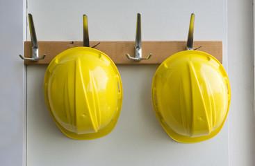 Helmets on coat hangers