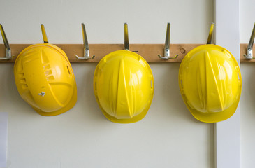 Helmets on coat hangers