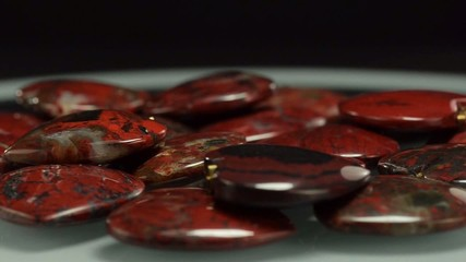Rotating brecciated jasper hearts
