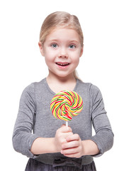 Beautiful little girl with lollipop isolated