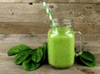 Healthy green smoothie with spinach in a jar mug on wood - 77758629