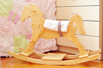 A beautiful handmade wooden horse in a kids' bedroom