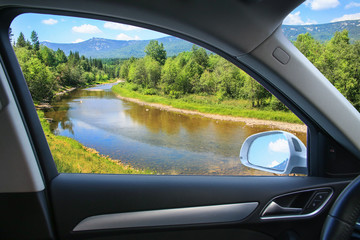 landscape with river from car window