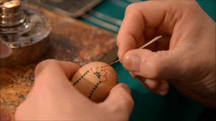 Painting a sorbian easter egg close up