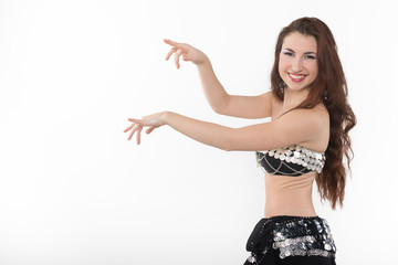 Portrait of young belly dancer against white background