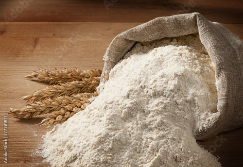 Tuinposter Eten Easter concept with copyspace. Flour spilled out of the bag and