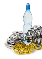 Concept of healthy lifestyle. Water, dumbbells, measuring tape