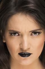 beautiful young woman wearing goth makeup
