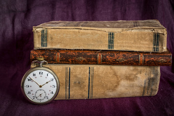 Vintage pocket watch and books