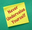 Never Undervalue Yourself yellow sticky note