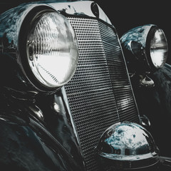 Old retro or vintage car front side. Vintage effect processing