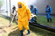 Man in chemical protection suit - 77764290