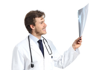 Handsome doctor man examining a radiography