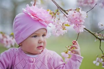 Baby girl portrait with sakura blossom