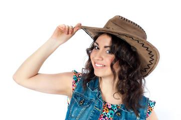 Smiling girl in cowboy hat