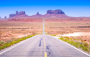 Desert highway leading into Monument Valley, Utah, USA