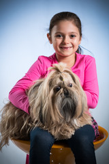 Girl posing with her dog