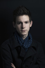 Young man in coat and scarf, portrait