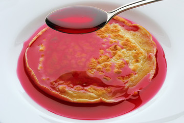 pancake with cherry syrup