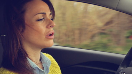 Closeup of woman driving side shot