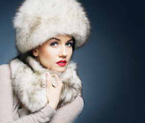 Fashion style portrait of a woman in an elegant winter clothes