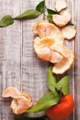Mandarin oranges on a  wooden background