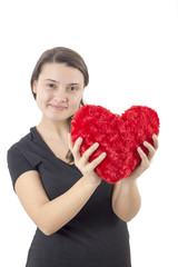 Young woman holding an red heart