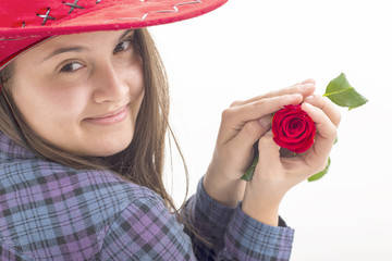 Girl with red hat holding an red rose