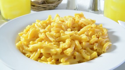 A forkful of macaroni and cheese being eaten