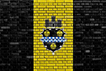 flag of Pittsburgh painted on brick wall