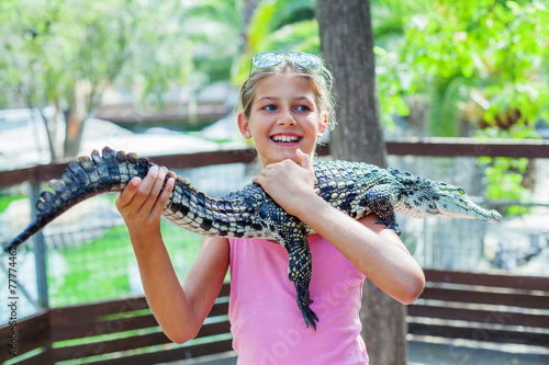 Fotobehang Krokodil Girl with crocodile.