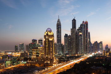 Dubai Marina Towers illuminated at night. Dubai, UAE