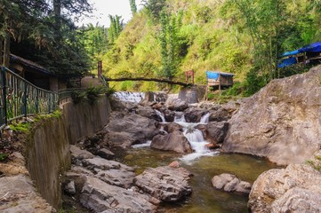 Rope bridgeover Tien Sa water fall in Sapa,Vietnam.
