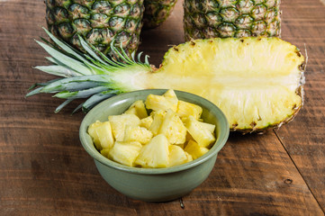 Pineapples and bowl of cut fruit