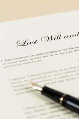 Last will on cream color paper and pen concept for legal documen