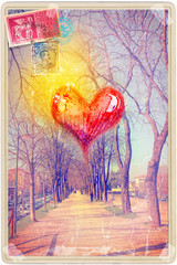 Vintage postcard with avenue and red heart