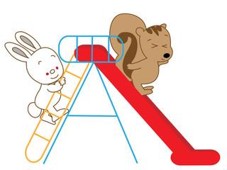滑り台で遊ぶ動物