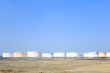 Large white tanks in tank farm for petrol and oil