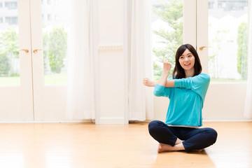 young asian woman exercising
