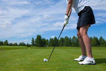 A Golfplayer with Golf ball  on golf course