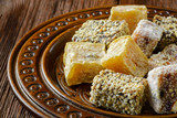 Turkish delight or rahat lokum on wooden plate. Selective focus poster