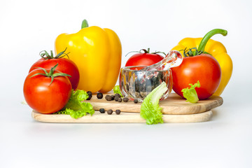 Sweet pepper of yellow color and ripe tomatoes
