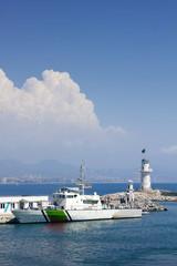 Lighthouse in port. Turkey, Alanya. Sunny weather