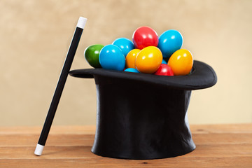 The magic of easter - colorful eggs in magician hats