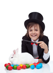 The magic of easter - happy magician boy and grumpy rabbit