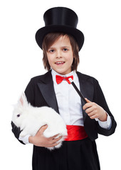 Young magician boy holding white rabbit